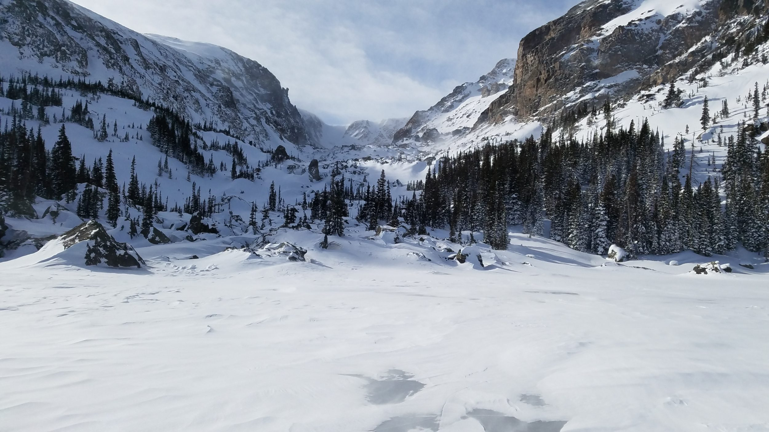 Standing on frozen Lake Haiyaha looking into Chaos Canyon
