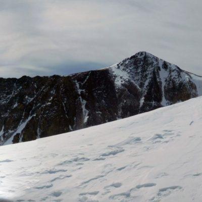Longs Peak summit behind Hallett Peak on the left, in the center is Hallett Peak, and Flattop Mountain on the right