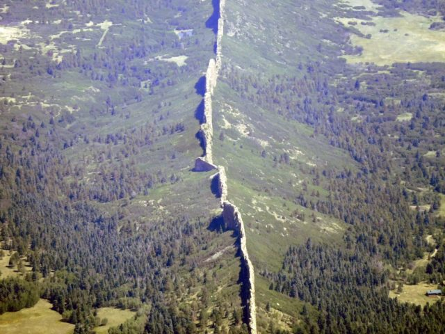 Dikes can be up to 14 miles long, 100 ft tall, and 100 ft wide
