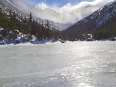 Mills Lake with Storm Peak (left) and Spearhead (right) rising above the blowing snow