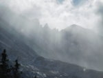 View of Keyboard of the Winds and Storm Peak in the blowing snow
