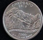 The Colorado Quarter portrays a view of Longs Peak, Keyboard of the Winds, and part of Pagoda Mountain from Mills Lake