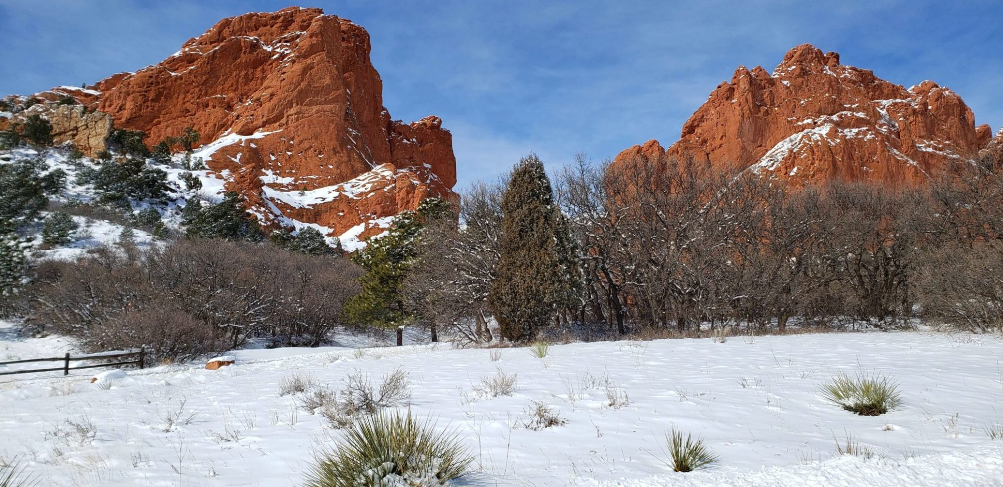 The red sandstone formations in stark contrast to the snow
