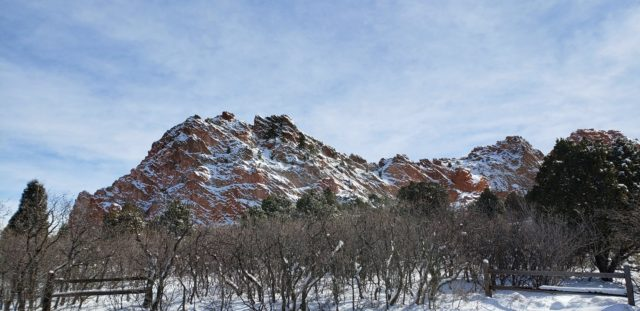 The red sandstone and fresh snow create interesting patterns on the rocks