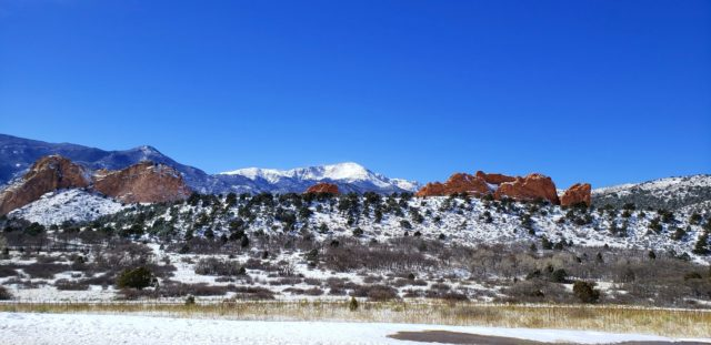 View of Garden of the Gods with the snow on Pikes Peak creating a bright reflection.