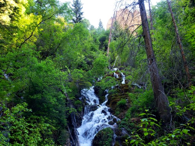 Immense waterfalls in the forest below Hanging Lake