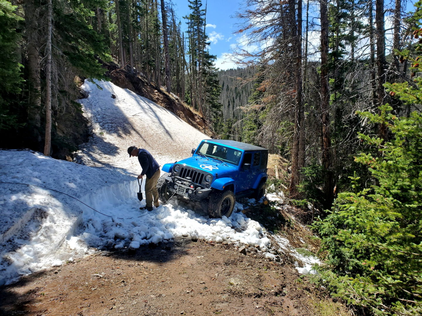 In serious jeopardy of having the driver side back wheel slide into the ravine. Time to winch.